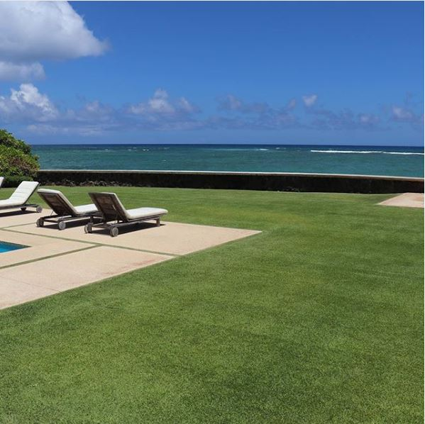 Image of ocean view on well manicured lawn by pacific outdoor living