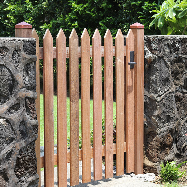 image of rock wall with wooden gate
